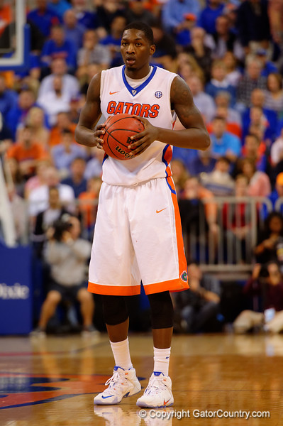 Florida Gators forward Dorian Finney-Smith stands at half-court during the first half.  Florida Gators vs LSU Tigers.  January 20th, 2015. Gator Country photo by David Bowie.