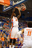 Florida Gators forward Dorian Finney-Smith win a slam dunk during the first half.  Florida Gators vs LSU Tigers.  January 20th, 2015. Gator Country photo by David Bowie.