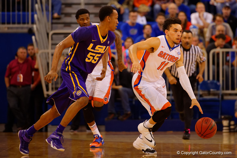 Florida Gators guard Chris Chiozza dribbles up court during the second half.  Florida Gators vs LSU Tigers.  January 20th, 2015. Gator Country photo by David Bowie.