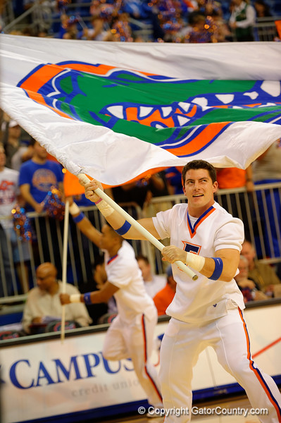 A Florida Gators cheerleader leads the Gators onto the court waiving the Gator fan.  Florida Gators vs LSU Tigers.  January 20th, 2015. Gator Country photo by David Bowie.
