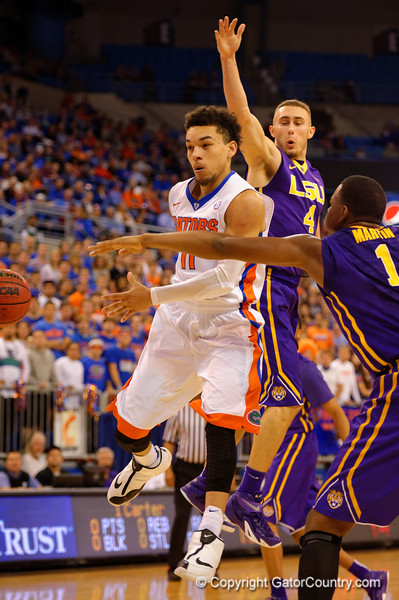 Florida Gators guard Chris Chiozza drives the lane and dishes off a no look pass while LSU Tigers forward Jarell Martin and LSU Tigers guard Keith Hornsby defend.  Florida Gators vs LSU Tigers.  January 20th, 2015. Gator Country photo by David Bowie.