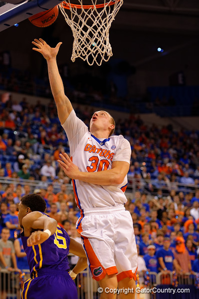 Florida Gators forward Jacob Kurtz with a lay up in the first half over LSU Tigers guard Jalyn Patterson in the first half.  Florida Gators vs LSU Tigers.  January 20th, 2015. Gator Country photo by David Bowie.