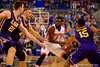 Florida Gators guard Eli Carter drives toward the basket but is met by LSU Tigers center Darcy Malone, LSU Tigers guard Keith Hornsby and LSU Tigers guard Jalyn Patterson.  Florida Gators vs LSU Tigers.  January 20th, 2015. Gator Country photo by David Bowie.