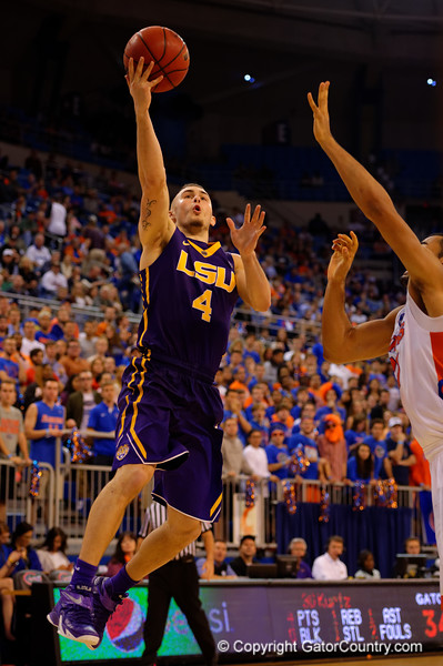 LSU Tigers guard Keith Hornsby drives toward the net during a fast break and scores on a lay up.  Florida Gators vs LSU Tigers.  January 20th, 2015. Gator Country photo by David Bowie.