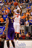 Florida Gators forward Dorian Finney-Smith leaps over LSU Tigers forward Jarell Martin and drains a three pointer in the second half.  Florida Gators vs LSU Tigers.  January 20th, 2015. Gator Country photo by David Bowie.