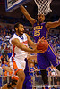 Florida Gators center Jon Horford passes around LSU Tigers forward Jordan Mickey during the first half.  Florida Gators vs LSU Tigers.  January 20th, 2015. Gator Country photo by David Bowie.