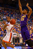 Florida Gators guard Kasey Hill with a no look pass around LSU Tigers forward Jordan Mickey during the first half.  Florida Gators vs LSU Tigers.  January 20th, 2015. Gator Country photo by David Bowie.