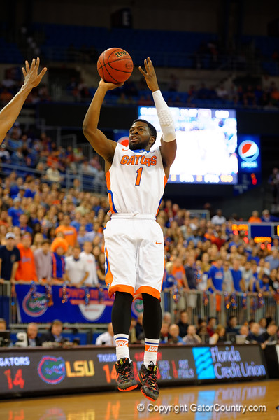 Florida Gators guard Eli Carter with a shot attempt during the first half.  Florida Gators vs LSU Tigers.  January 20th, 2015. Gator Country photo by David Bowie.
