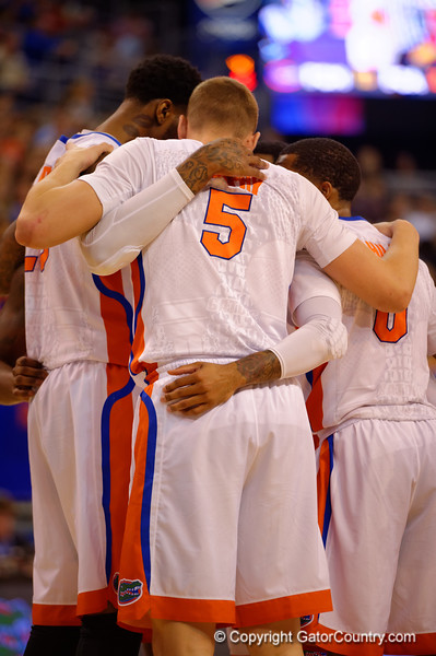 The Florida Gators huddle together during a timeout in the first half.  Florida Gators vs LSU Tigers.  January 20th, 2015. Gator Country photo by David Bowie.