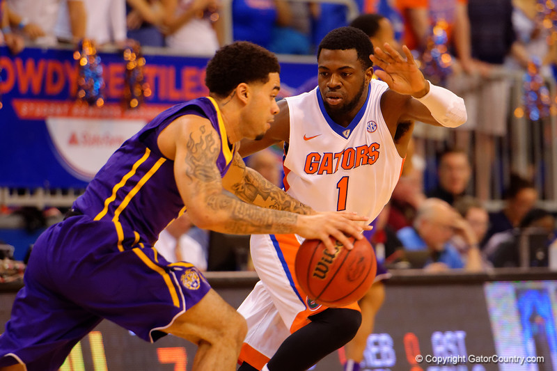 Florida Gators guard Eli Carter defending LSU Tigers guard Josh Gray as Gray attempts to get past the Gators full court press.  Florida Gators vs LSU Tigers.  January 20th, 2015. Gator Country photo by David Bowie.