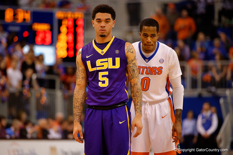 LSU Tigers guard Josh Gray and Florida Gators guard Kasey Hill wait for play to resume during the first half.  Florida Gators vs LSU Tigers.  January 20th, 2015. Gator Country photo by David Bowie.