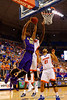 LSU Tigers forward Jordan Mickey leaps toward the basket as Florida Gators forward Dorian Finney-Smith defends during the second half.  Florida Gators vs LSU Tigers.  January 20th, 2015. Gator Country photo by David Bowie.