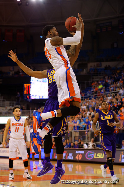 Florida Gators forward Chris Walker leaps into the air toward the basket but mishandles the ball in the air.  Florida Gators vs LSU Tigers.  January 20th, 2015. Gator Country photo by David Bowie.