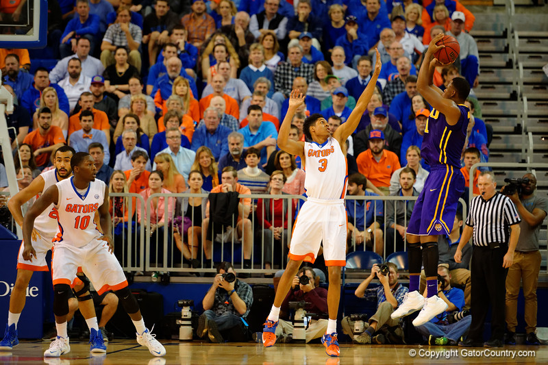 Florida Gators forward Devin Robinson defends as LSU Tigers forward Jarell Martin drains a 3-point bucket in the first half.  Florida Gators vs LSU Tigers.  January 20th, 2015. Gator Country photo by David Bowie.