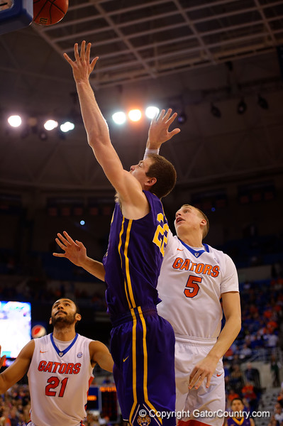 Florida Gators forward Alex Murphy leaps in an attemot to block a shot by LSU Tigers center Darcy Malone during the second half.  Florida Gators vs LSU Tigers.  January 20th, 2015. Gator Country photo by David Bowie.