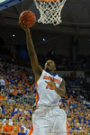 Florida Gators forward Dorian Finney-Smith lays in the basket during the first half as the Florida Gators defeat the LSU Tigers 68-62 at the Stephen C. O'Connell Center.  January 9th, 2016. Gator Country photo by David Bowie.