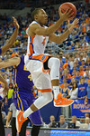 Florida Gators guard KeVaughn Allen leaps into the air for a basket during the second half as the Florida Gators defeat the LSU Tigers 68-62 at the Stephen C. O'Connell Center.  January 9th, 2016. Gator Country photo by David Bowie.
