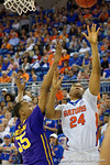 Florida Gators guard Justin Leon fights for a rebound versus LSU Tigers guard Tim Quarterman during the second half as the Florida Gators defeat the LSU Tigers 68-62 at the Stephen C. O'Connell Center.  January 9th, 2016. Gator Country photo by David Bowie.
