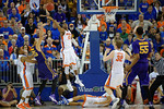 Florida Gators forward Kevarrius Hayes leaps into the air trying to block the shot by LSU Tigers forward Ben Simmons during the second half as the Florida Gators defeat the LSU Tigers 68-62 at the Stephen C. O'Connell Center.  January 9th, 2016. Gator Country photo by David Bowie.