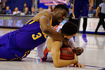 LSU Tigers center Elbert Robinson III tries to steal the ball away from Florida Gators guard Chris Chiozza during the second half as the Florida Gators defeat the LSU Tigers 68-62 at the Stephen C. O'Connell Center.  January 9th, 2016. Gator Country photo by David Bowie.