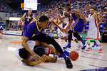 LSU Tigers guard Tim Quarterman and Florida Gators guard Justin Leon dive for a loose ball during the second half as the Florida Gators defeat the LSU Tigers 68-62 at the Stephen C. O'Connell Center.  January 9th, 2016. Gator Country photo by David Bowie.