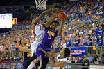 LSU Tigers guard Antonio Blakeney is fouled while leaping for a rebound by Florida Gators center John Egbunu during the first half as the Florida Gators defeat the LSU Tigers 68-62 at the Stephen C. O'Connell Center.  January 9th, 2016. Gator Country photo by David Bowie.