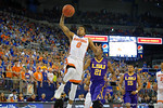 Florida Gators guard Kasey Hill leaps into the air toward the basket during the first half as the Florida Gators defeat the LSU Tigers 68-62 at the Stephen C. O'Connell Center.  January 9th, 2016. Gator Country photo by David Bowie.