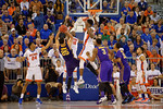 Florida Gators forward Dorian Finney-Smith leaps to block a shot by LSU Tigers forward Ben Simmons during the second half as the Florida Gators defeat the LSU Tigers 68-62 at the Stephen C. O'Connell Center.  January 9th, 2016. Gator Country photo by David Bowie.
