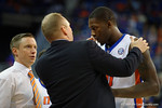 Florida Gators forward Dorian Finney-Smith is checked on after his lip is split open during the second half as the Florida Gators defeat the LSU Tigers 68-62 at the Stephen C. O'Connell Center.  January 9th, 2016. Gator Country photo by David Bowie.