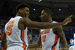 Florida Gators center John Egbunu pointed out instructions to Florida Gators forward Dorian Finney-Smith during the first half as the Florida Gators defeat the LSU Tigers 68-62 at the Stephen C. O'Connell Center.  January 9th, 2016. Gator Country photo by David Bowie.