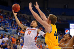 Florida Gators guard Chris Chiozza lays in a bucket during the first half as the University of Florida Gators win at home over the Vermont Catamounts 86-62.  Florida Gators vs Vermont Catamounts.  November 25th, 2015. Gator Country photo by David Bowie.