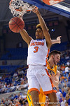 Florida Gators forward Devin Robinson dunks during the second half as the University of Florida Gators win at home over the Vermont Catamounts 86-62.  Florida Gators vs Vermont Catamounts.  November 25th, 2015. Gator Country photo by David Bowie.