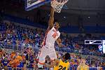 Florida Gators center John Egbunu dunks during the first half as the University of Florida Gators win at home over the Vermont Catamounts 86-62.  Florida Gators vs Vermont Catamounts.  November 25th, 2015. Gator Country photo by David Bowie.