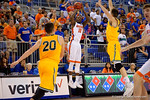 Florida Gators forward Dorian Finney-Smith burns a three pointer during the first half as the University of Florida Gators win at home over the Vermont Catamounts 86-62.  Florida Gators vs Vermont Catamounts.  November 25th, 2015. Gator Country photo by David Bowie.