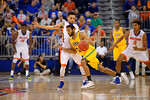 Florida Gators guard Chris Chiozza guarding during the first half as the University of Florida Gators win at home over the Vermont Catamounts 86-62.  Florida Gators vs Vermont Catamounts.  November 25th, 2015. Gator Country photo by David Bowie.