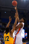 Florida Gators center John Egbunu with a sky hook shot during the first half as the University of Florida Gators win at home over the Vermont Catamounts 86-62.  Florida Gators vs Vermont Catamounts.  November 25th, 2015. Gator Country photo by David Bowie.