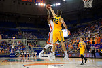 Florida Gators forward Dorian Finney-Smith shoots during the second half as the University of Florida Gators win at home over the Vermont Catamounts 86-62.  Florida Gators vs Vermont Catamounts.  November 25th, 2015. Gator Country photo by David Bowie.