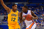 Florida Gators forward Dorian Finney-Smith drives toward the basket during the first half as the University of Florida Gators win at home over the Vermont Catamounts 86-62.  Florida Gators vs Vermont Catamounts.  November 25th, 2015. Gator Country photo by David Bowie.