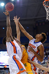 Florida Gators forward Devin Robinson leaps for a rebound during the second half as the University of Florida Gators win at home over the Vermont Catamounts 86-62.  Florida Gators vs Vermont Catamounts.  November 25th, 2015. Gator Country photo by David Bowie.