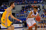 Florida Gators forward Devin Robinson dribbles toward the net during the first half as the University of Florida Gators win at home over the Vermont Catamounts 86-62.  Florida Gators vs Vermont Catamounts.  November 25th, 2015. Gator Country photo by David Bowie.