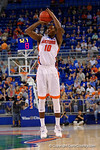 Florida Gators forward Dorian Finney-Smith drains a three pointer during the first half as the University of Florida Gators win at home over the Vermont Catamounts 86-62.  Florida Gators vs Vermont Catamounts.  November 25th, 2015. Gator Country photo by David Bowie.