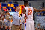 Florida Gators head coach Mike White coaching up Florida Gators forward Kevarrius Hayes during the second half as the University of Florida Gators win at home over the Vermont Catamounts 86-62.  Florida Gators vs Vermont Catamounts.  November 25th, 2015. Gator Country photo by David Bowie.