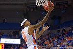 Florida Gators guard Kasey Hill lays in the basket during the second half as the University of Florida Gators win at home over the Vermont Catamounts 86-62.  Florida Gators vs Vermont Catamounts.  November 25th, 2015. Gator Country photo by David Bowie.