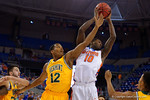 Florida Gators forward Dorian Finney-Smith leaps for a rebound during the first half as the University of Florida Gators win at home over the Vermont Catamounts 86-62.  Florida Gators vs Vermont Catamounts.  November 25th, 2015. Gator Country photo by David Bowie.