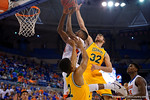 Florida Gators guard DeVon Walker flies toward the basket during the first half as the University of Florida Gators win at home over the Vermont Catamounts 86-62.  Florida Gators vs Vermont Catamounts.  November 25th, 2015. Gator Country photo by David Bowie.