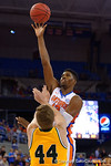 Florida Gators forward Kevarrius Hayes leaps into the air during the first half as the University of Florida Gators win at home over the Vermont Catamounts 86-62.  Florida Gators vs Vermont Catamounts.  November 25th, 2015. Gator Country photo by David Bowie.