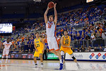 Florida Gators center Schuyler Rimmer lays in a basket during the second half as the University of Florida Gators win at home over the Vermont Catamounts 86-62.  Florida Gators vs Vermont Catamounts.  November 25th, 2015. Gator Country photo by David Bowie.