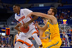 Florida Gators guard DeVon Walker grabs a rebound during the first half as the University of Florida Gators win at home over the Vermont Catamounts 86-62.  Florida Gators vs Vermont Catamounts.  November 25th, 2015. Gator Country photo by David Bowie.