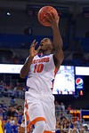 Florida Gators forward Dorian Finney-Smith shoots during the first half as the University of Florida Gators win at home over the Vermont Catamounts 86-62.  Florida Gators vs Vermont Catamounts.  November 25th, 2015. Gator Country photo by David Bowie.