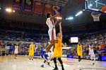 Florida Gators forward Devin Robinson shoots during the second half as the University of Florida Gators win at home over the Vermont Catamounts 86-62.  Florida Gators vs Vermont Catamounts.  November 25th, 2015. Gator Country photo by David Bowie.